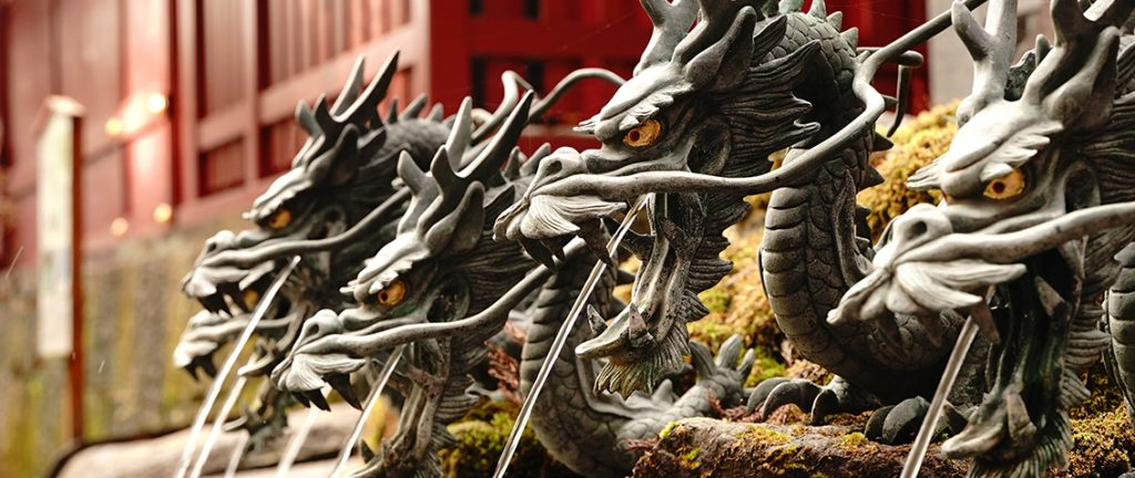 Nine head dragon statue water server at hand washing place of Kuzuryu Jinja Shrine Shingu at Hakone Kanagawa Japan. Chozuya. Temizusha.